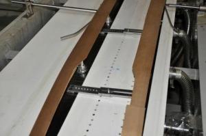 Механизм проводки заготовки пакета